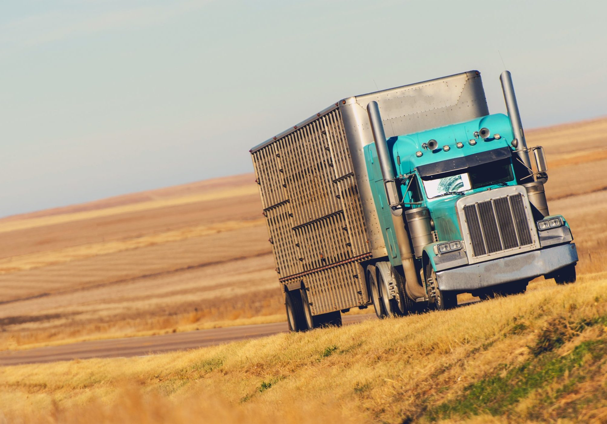 Semi Truck on the American Prairie Road in Colorado. United States of America. Trucking and Shipping Theme.